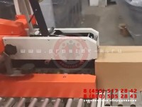 Линия автоматической укладки товаров в коробки с заклейкой